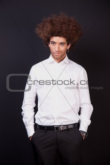 Portrait of a happy and young  man isolated on black background. Studio shot.