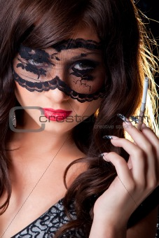 brunette girl with silver mouthpiece