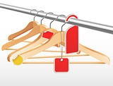 Wooden hangers with sale tags and stickers