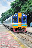Thai colorful train arriving at station