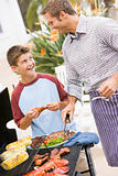 Father And Son Barbequing