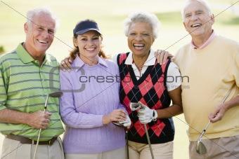 Portrait Of Four Friends Enjoying A Game Golf