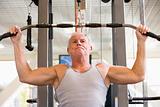 Man Weight Training At Gym