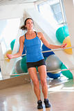 Woman Using Skipping Rope At Gym