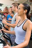 Woman Running On Treadmill At Gym