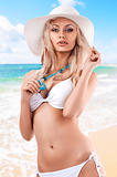 blond girl with white summer hat
