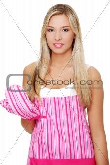 Beautiful happy young blond woman wearing kitchen apron