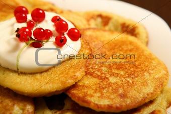 Potato pancakes with redcurrant