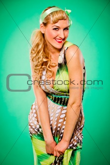 Portrait of smiling beautiful woman with long blonde hair. Pin-up and retro style.
