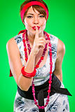 Sensual girl with finger near mouth showing silence gesture. Pin-up and retro style .  