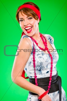 Portrait of cheerful beautiful girl with red  jewelry. Pin-up and retro style