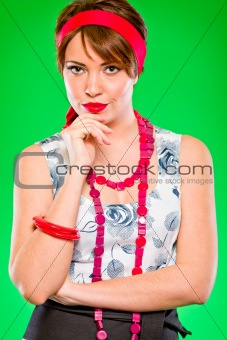 Portrait of pensive charming girl holding hand near head. Pin-up and retro style