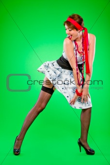 Sexy woman looking on dress  blown up  by wind. Pin-up and retro style.