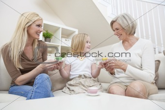Mother, Daughter, Grandmother Generations at Home Playing wih Te