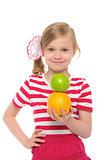 Happy girl with orange and apple