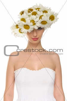 beautiful woman in hat of daisies and white dress