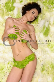woman with cabbage and green lettuce