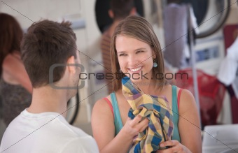 Flirting Woman in Laundromat