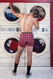 Man in underwear at the dryer