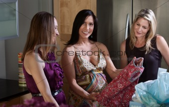 Happy Pregnant Lady With Baby Shower Gift