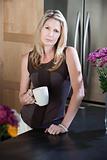 Serious Woman with Coffee Mug