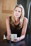 Blonde Woman Holding Coffee Mug