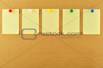 Blank sticky notes pinned