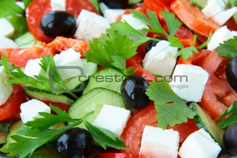 Greek salad with olives, tomatoes and feta cheese