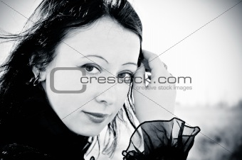 Portrait of smiling beautiful gothic girl. Black and white photo