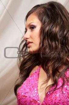 Beautiful brunette woman in evening dress
