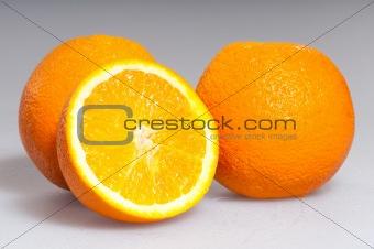 three ripe oranges