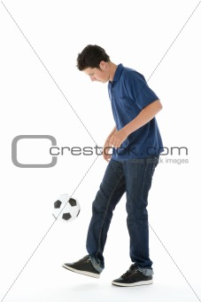 Portrait Of Teenage Boy With A Soccer Ball