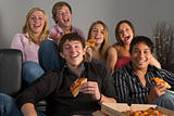 Teenagers Having Fun And Eating Pizza