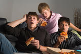 Teenage Boys Eating Pizza