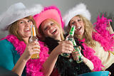 Dressed Up Teenage Girls Enjoying Drinks