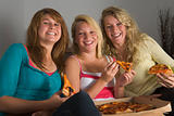 Teenage Girls Eating Pizza
