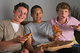 Teenage Boys Enjoying Pizza