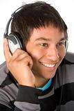 Teenage Boy Listening To Music On Headphones