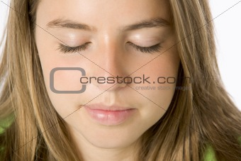 Portrait Of Teenage Girl With Eyes Closed