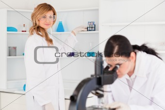 Two scientists conducting an experiment