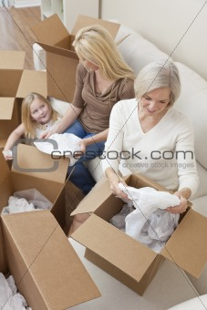 Female Generations of Family Unpacking Boxes Moving House