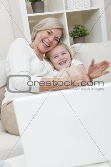 Senior Woman Grandmother & Grandaughter Girl Having Fun With Lap