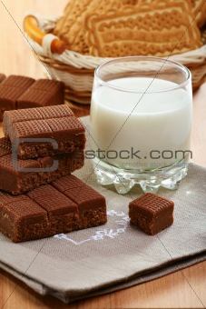 Toffee and a glass of milk on a linen napkin.