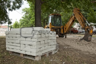 Tile paths construction with loader