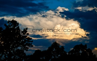 stormy sky cloudscape with storm clouds silhouette and sunlight