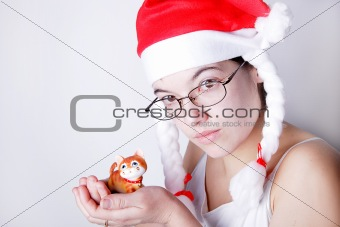 Santa girl with a toy