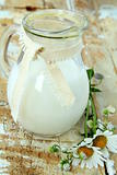 pitcher of milk on a wooden table rustic still life