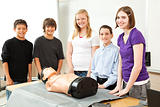 Teenagers with CPR Training Mannequin