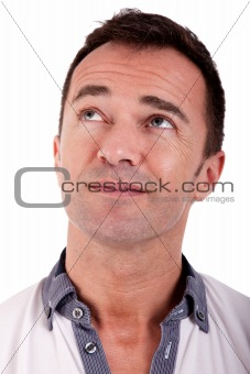 Portrait of a handsome middle-age man, looking up. on white background. Studio shot