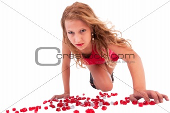Beautiful woman on their knees, wearing a red dress, on white, studio shot
